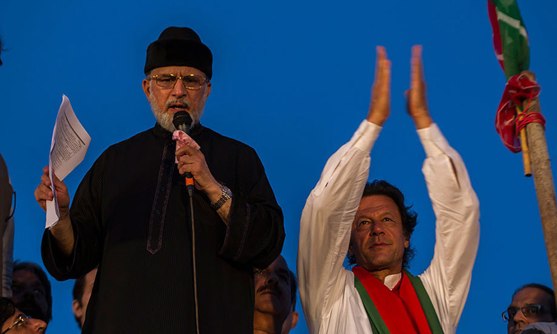 Tahirul Qadri and Imran Khan address supporters in Islamabad at rally against Nawaz Sharif. — Reuters