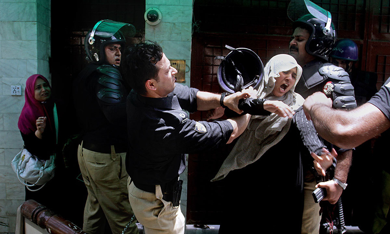 Police grappling with a protester — AP file photo
