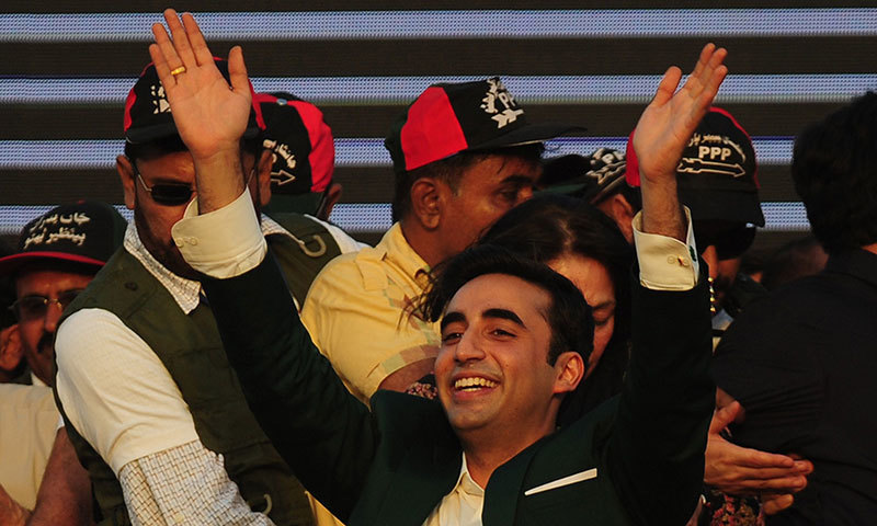 Bilawal Bhutto Zardari waves to supporters during his arrival for a public gathering in Karachi on October 18, 2014. – AFP Photo