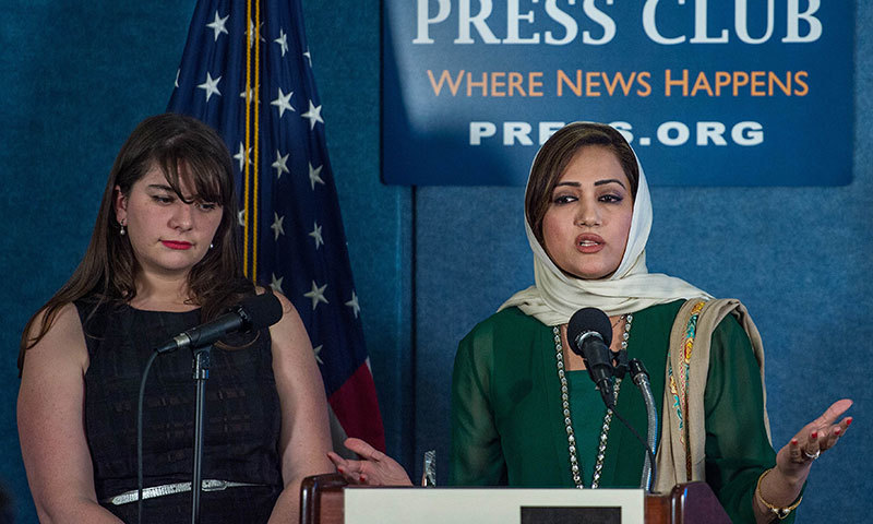 Asma Shirazi speaks as she receives the Peter Mackler Award for Courageous and Ethical Journalism at the National Press Club in Washington, DC on October 23, 2014. – AFP Photo