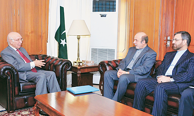 ISLAMABAD: Adviser to PM on Foreign Affairs and National Security Sartaj Aziz in a meeting with Iranian Deputy Foreign Minister Ibrahim Rahimpour.—INP