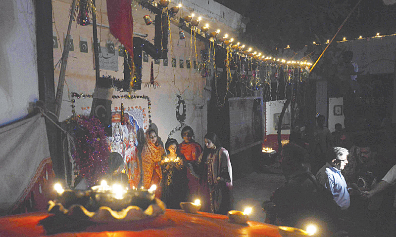 Diwali being celebrated at the Valmiki Mandir in New Anarkali. The temple is not only a worship place but also home to Lahore's poverty-stricken Valmiki community.—Arif Ali / White Star