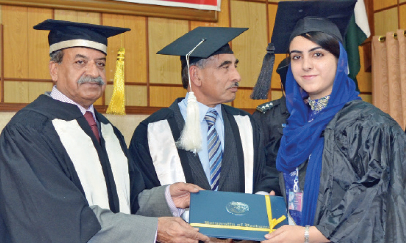 Governor Mehtab Ahmad Khan awards degree to a student at the convocation. — Dawn