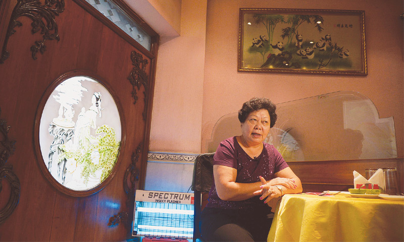 Monica Liu in her restaurant in Kolkata. Suspected of being a spy, 9 year old Liu & her family were sent to detention camps in the deserts of Rajasthan. Source ~ dawn.com