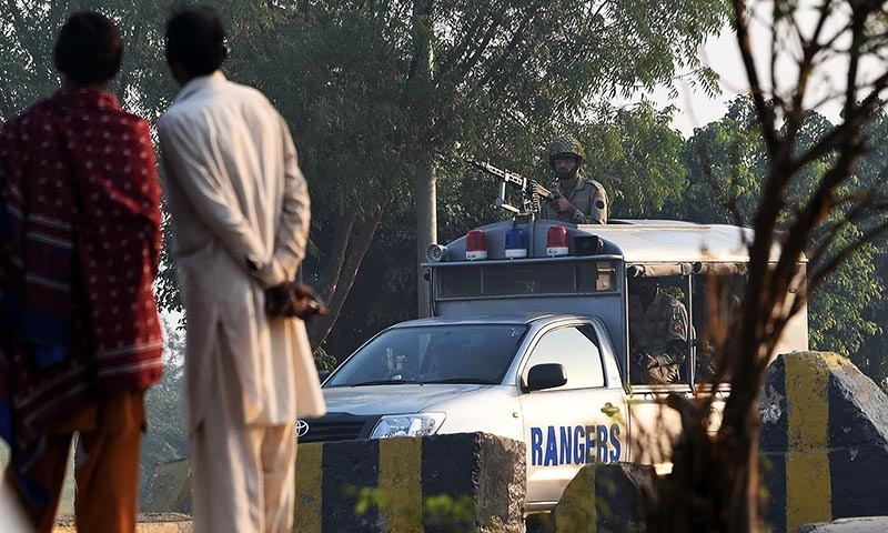 Paramilitary troops patrol a day after a suicide bombing, along a street leading to the Wagah border on November 3, 2014.  - AFP