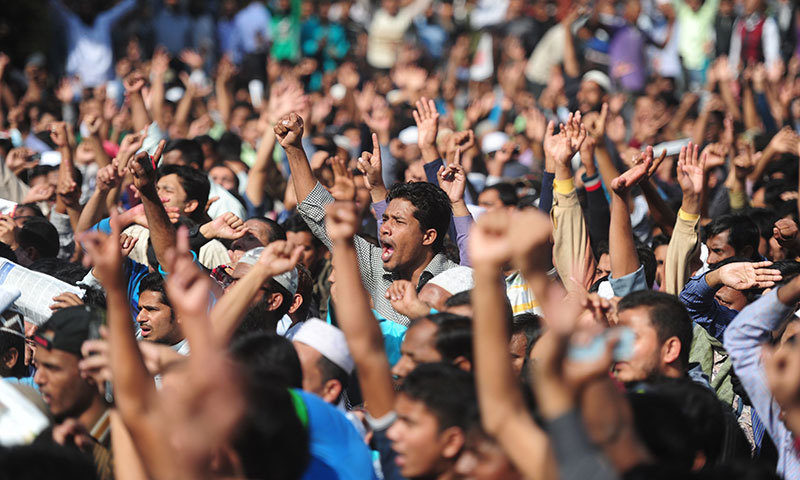 Activists of Jamaat-e-Islami acknowledge their leader during a rally in Dhaka. Bangladesh's largest Islamist party faces an existential crisis after a series of body blows, including the sentencing to death of its leaders and abandonment by its main secular ally, say analysts. — Photo by AFP