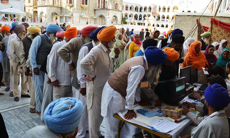 Sikh pilgrims register themselves on arrival to participate in the birth celebrations of Baba Guru Nanak at Gurdwara Panja Sahib - Online/File