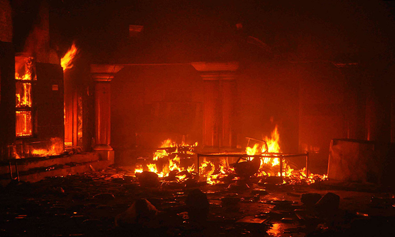 A temple burns after it was attacked in Larkana on March 15, 2014. — Reuters/file