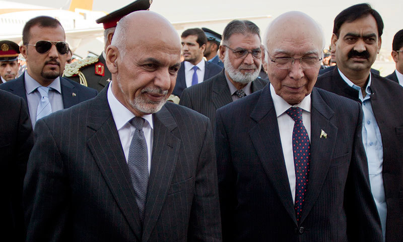 Adviser on National Security and Foreign Affairs Sartaj Aziz (R) greets Afghan President Ashraf Ghani at Chaklala airbase in Rawalpindi, Pakistan, Friday, November 14, 2014. - AP photo