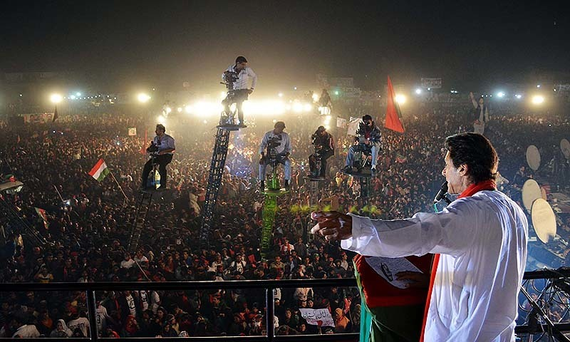 Tehreek-i-Insaf (PTI) Chairman, Imran Khan addresses to  his supporters during Public Gathering Meeting held in Sahiwal District on Saturday, November  15, 2014.- PPI