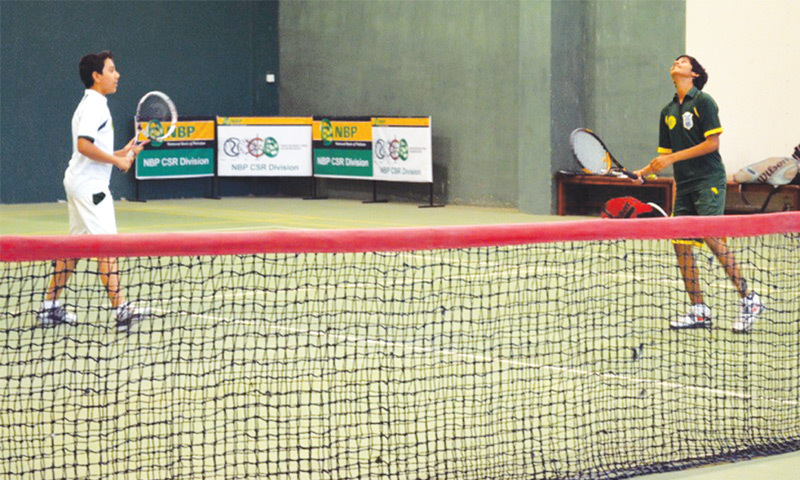 KARACHI: Kids in action during the inter-school tennis event at the NBP Sports Complex.