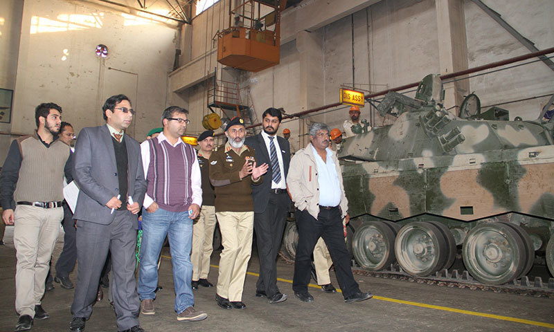 Brigadier Sanaullah briefing journalists during a guided tour of the Heavy Industries Taxila (HIT).