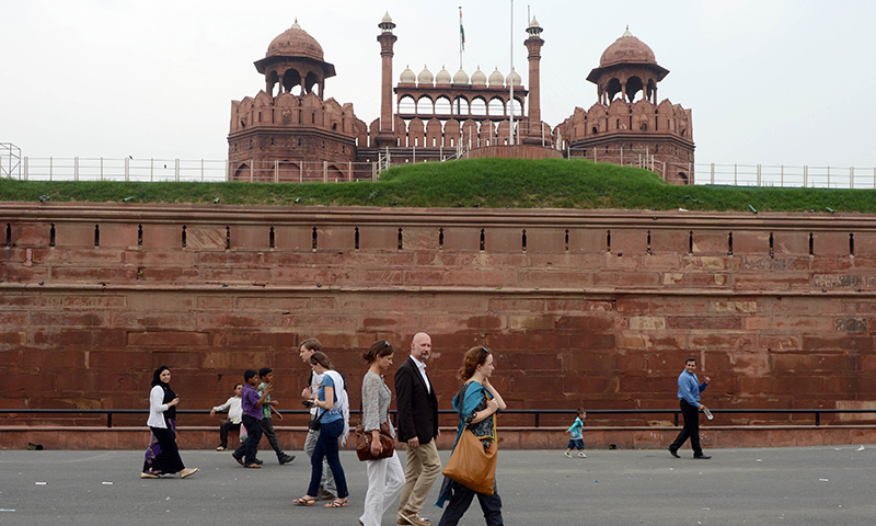 Foreign tourists visit the landmark Red Fort, constructed in the 17th century by Mughal emperor Shah Jahan, in New Delhi, India. — AFP/File