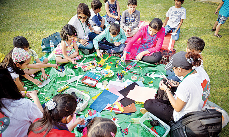 CHILDREN take part in an art and craft workshop at the Creative Karachi Festival at the Alliance Francaise on Saturday. —Fahim Siddiqi/White Star