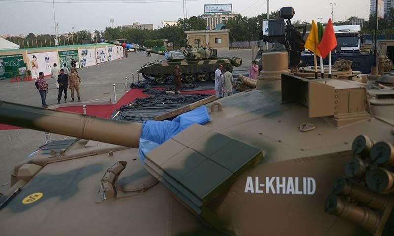 Al-Khalid (foreground) and Al-Zarrar battle tanks are pictured during final preparations on the exhibition floor for the International Defence Exhibition and seminar (IDEAS) in Karachi on November 29, 2014. - AFP