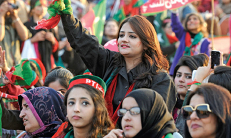 Women supporters in a festive mood at the PTI rally in Islamabad on Sunday. — Photo by Tanveer Shahzad