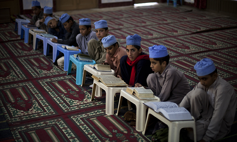 Students of a local madrassa, or Islamic school, recite verses of the Quran.   — AP/file