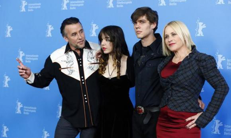 (L-R) Director, screenwriter and producer Richard Linklater and cast members Lorelei Linklater, Ellar Coltrane and Patricia Arquette pose during a photocall to promote the movie ''Boyhood'' during the 64th Berlinale International Film Festival in Berlin February 13, 2014. - Reuters