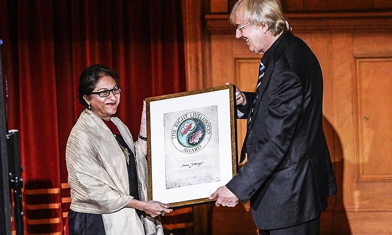 Human rights lawyer Asma Jahangir (L) receives the Right Livelihood Award from Jakob von Uexkull (R) during the Right Livelihood Award ceremony at the 2nd chamber hall at the Swedish Parliament, in Stockholm, Sweden, December 1, 2014. — AFP