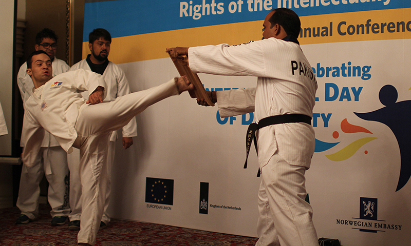 One of the trainees broke a wood board which was part of their martial arts training. — Photo by Yumna Rafi