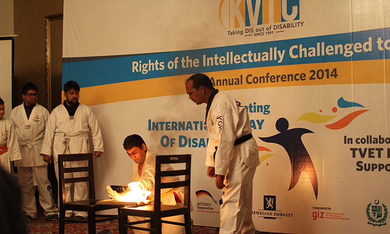Trainees at Karachi Vocational Training Centre show their taekwondo skills at the conference. — Photo by Yumna Rafi