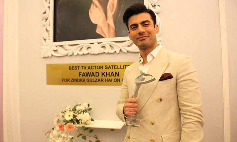 Fawad Khan with his Lux Style Award for Best Actor Drama (Sateliite). — Photo by Mahjabeen Mankani