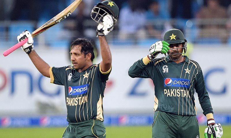 Pakistani batsman Sarfraz Ahmed (L) celebrates after scoring half century (50 runs) during the first International T20 cricket match at Dubai International Stadium in Dubai. -AFP Photo
