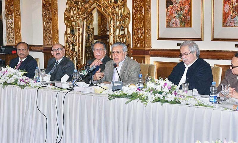 Federal Minister for Finance, Ishaq Dar addressing representatives of APNS. — APP