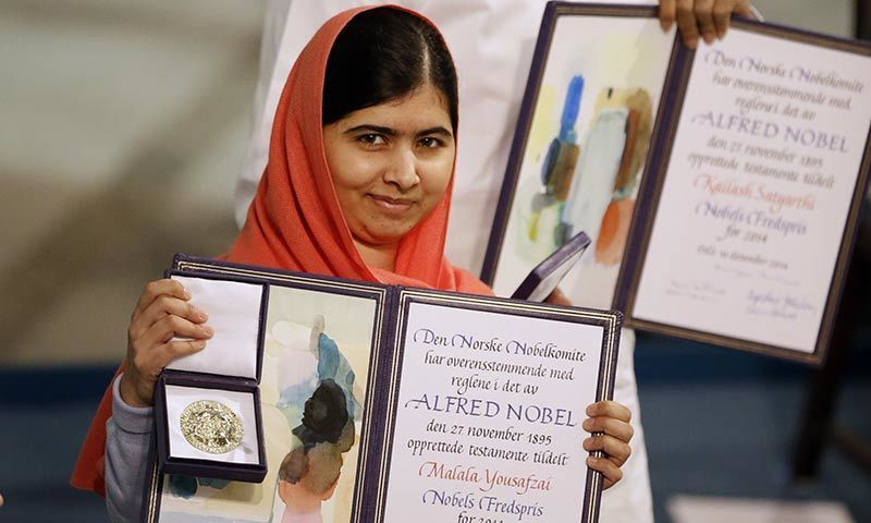 Nobel Peace Prize winners Malala Yousafzai from Pakistan, front, and Kailash Satyarthi of India are awarded their Nobel Peace Prize during the Nobel Peace Prize award ceremony in Oslo, Norway. -AP Photo