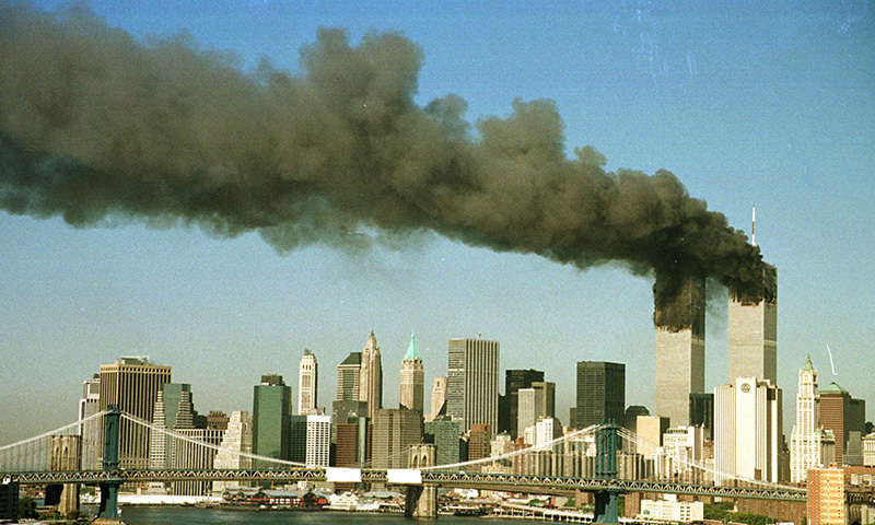 The towers of the World Trade Center pour smoke shortly after being struck by hijacked commercial airplanes in New York in this September 11, 2001.— Reuters/file
