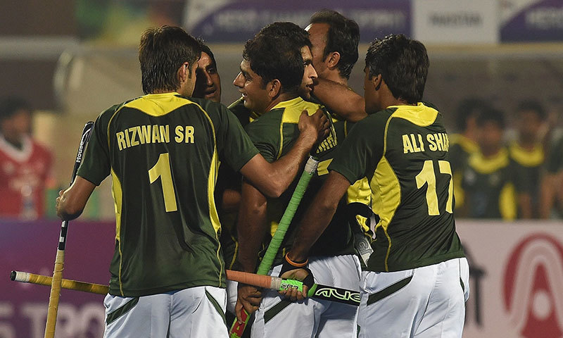Pakistan hockey players celebrate a goal against India. – AFP