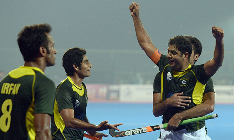 Pakistan hockey captain Imran Muhammad (2R) celebrates his team's victory over India. – AFP