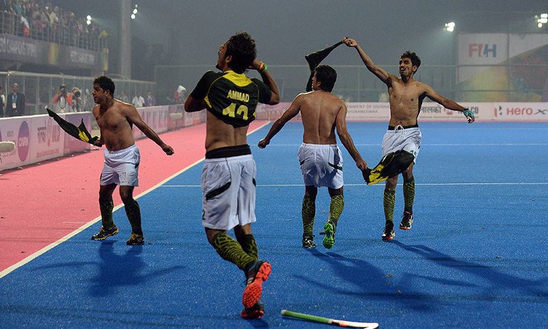 Pakistan captain Mohammad Imran (L) celebrates with teammates after winning the Hero Hockey Champions Trophy 2014 semi final match against India in Bhubaneswar. — AFP