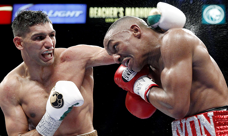 Welterweight boxer Amir Khan (L) battles with Devon Alexander of the US during a welterweight fight at the MGM Grand Garden Arena in Las Vegas, Nevada. — Reuters