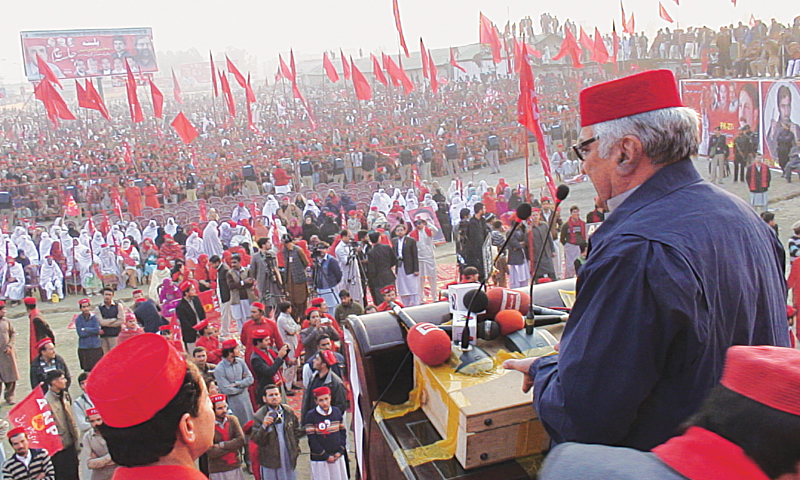 MARDAN: Awami National Party chief Asfandyar Wali Khan addressing a public meeting here on Sunday.—White Star