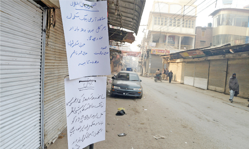COMPLETE shutter down in Peshawar Saddar against the school attack. — Photo by Shahbaz Butt