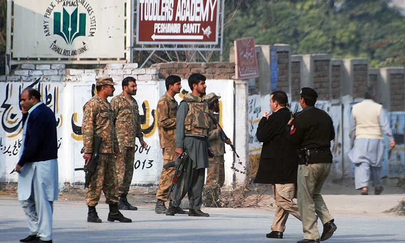 Pakistani security forces take up positions on a road leading to the Army Public School that is under attack. — Reuters/File