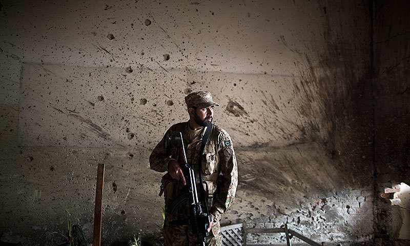 A soldier stands in the Army Public School after the attack. —AP