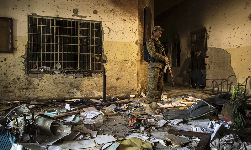 An army soldier stands inside the Army Public School, which was attacked by Taliban gunmen, in Peshawar, December 17, 2014. —Reuters