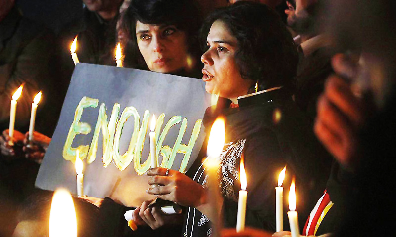 Civil society members take part in a candle light vigil for the victims of the Army Public School in Peshawar. —AP