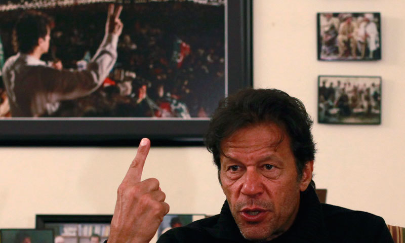 Imran Khan speaks during an interview at his office.—Reuters/File