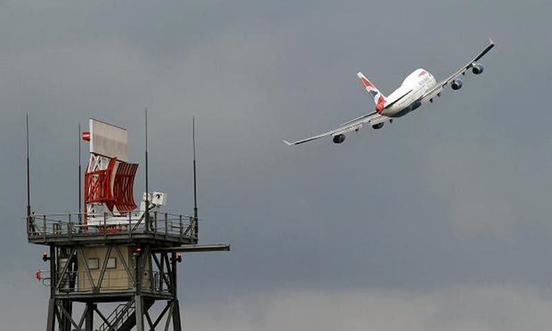 "A British Airways Boeing 747 ""Jumbo Jet"" takes off past a radar. — Reuters/File"