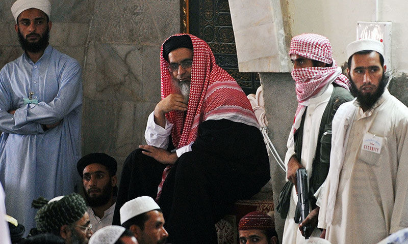 In this photograph taken on April 17, 2009, Lal Masjid's chief cleric Maulana Abdul Aziz (C) prepares to lead Friday prayers in Islamabad.  – AFP/File