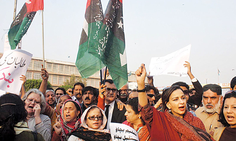 Human rights activists, joined by PPP leader Sherry Rehman, on Tuesday afternoon stage a protest demonstration outside the Karachi office of the Jamaat-i-Islami. They blamed the religio-political party for not condemning terrorism in all its forms.— Online