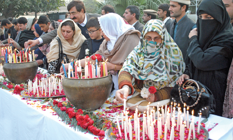 Lawmakers of Khyber Pakhtunkhwa Assembly light candles on the assembly premises in Peshawar on Tuesday to remember the children of Army Public School. — White Star
