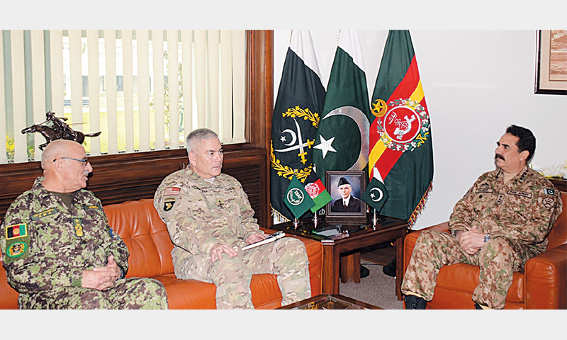 RAWALPINDI: This photograph released by the Inter Services Public Relations shows Army Chief Raheel Sharif with Gen Sher Mohammad Karimi, Chief of General Staff of Afghan National Army (left), and General John Campbell, Commander of Isaf (centre), during a meeting at the General Headquarters here on Tuesday.—AFP