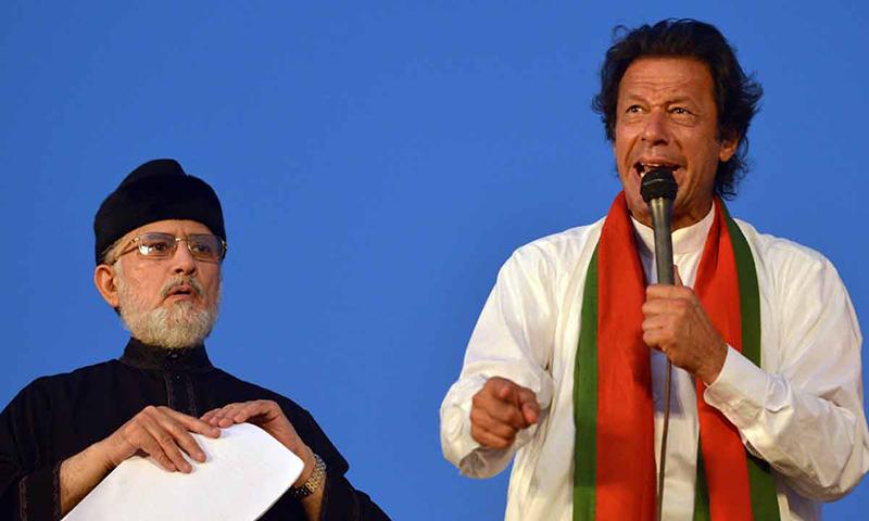 In this photo, Pakistan Awami Tehreek chief Dr Tahirul Qadri and Pakistan Tehreek-i-Insaf Chairman Imran Khan addressing a rally in Islamabad. — AFP/File