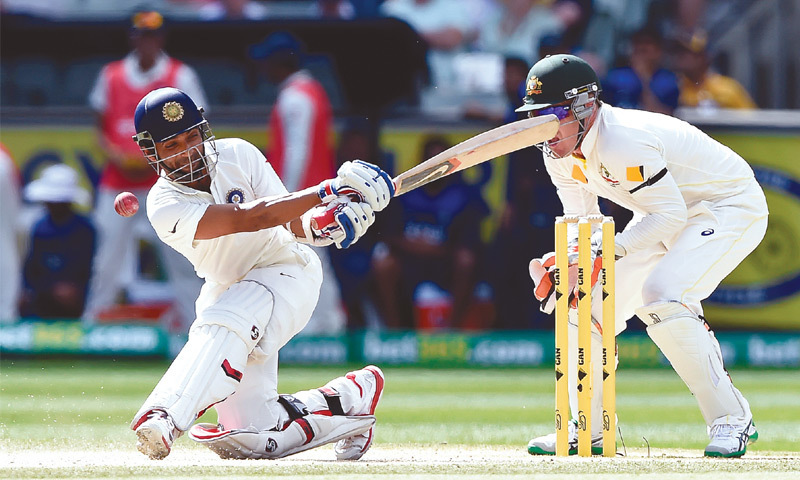 MELBOURNE: Indian batsman Ajinkya Rahane is trapped LBW for 147 during the third Test against Australia at the Melbourne Cricket Ground on Sunday.—AP