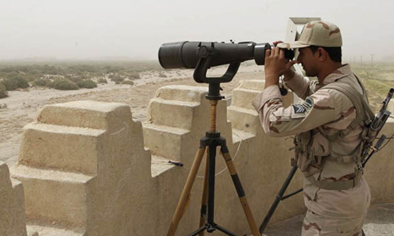 This picture shows an Iranian border guard looking through a pair of binoculars to monitor the area — AFP/File