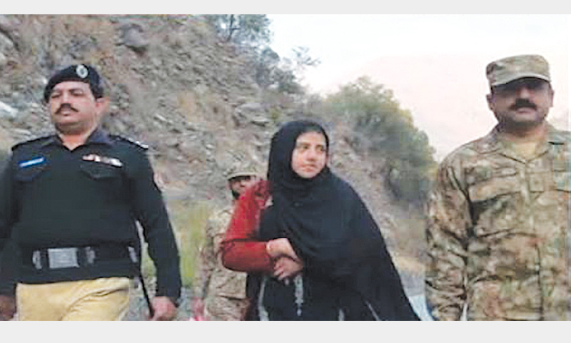 MUZAFFARABAD: Nasreen Bibi, a resident of Shoran village of Uri area of India-held  Kashmir, is being taken by Pakistani security officials to the Chakothi-Uri crossing point for handover to Indian authorities.